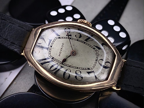 Art Deco Movado Tonneau shaped watch, in 14ct Gold, with Original dial