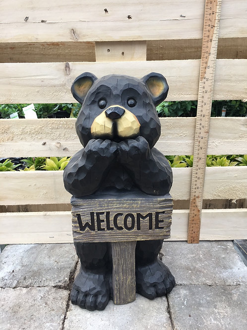Bear Leans on Welcome Sign