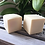 Two Coconut Milk Shampoo Bars out of their cardboard packaging