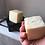 Hand holding plastic free natural Chamomile Shampoo Bar
