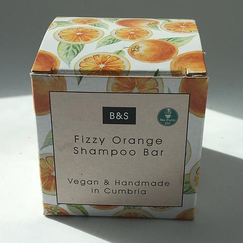 Natural shampoo bar fragranced with fizzy orange