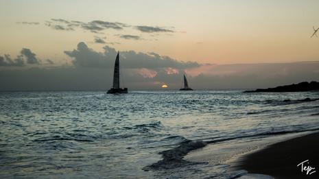 A Sunset between Sailboats