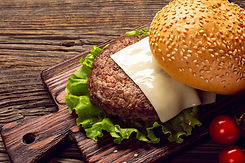 close-up-burger-ingredients-cutting-boar