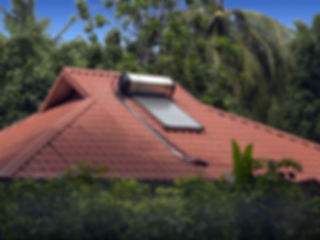 Solar water heater sits on the roof of a