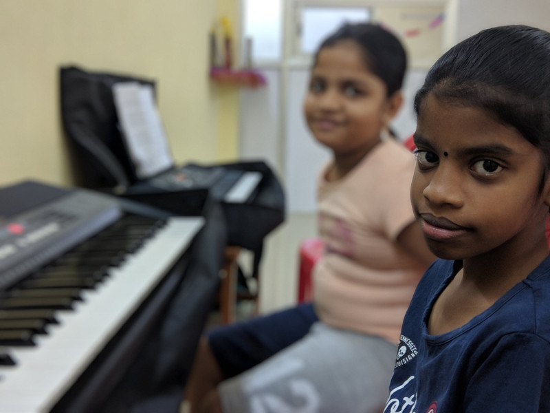 Students learning Keyboard Classes
