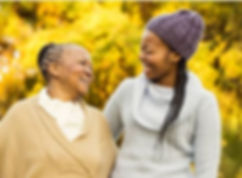elderly women laughs with carer
