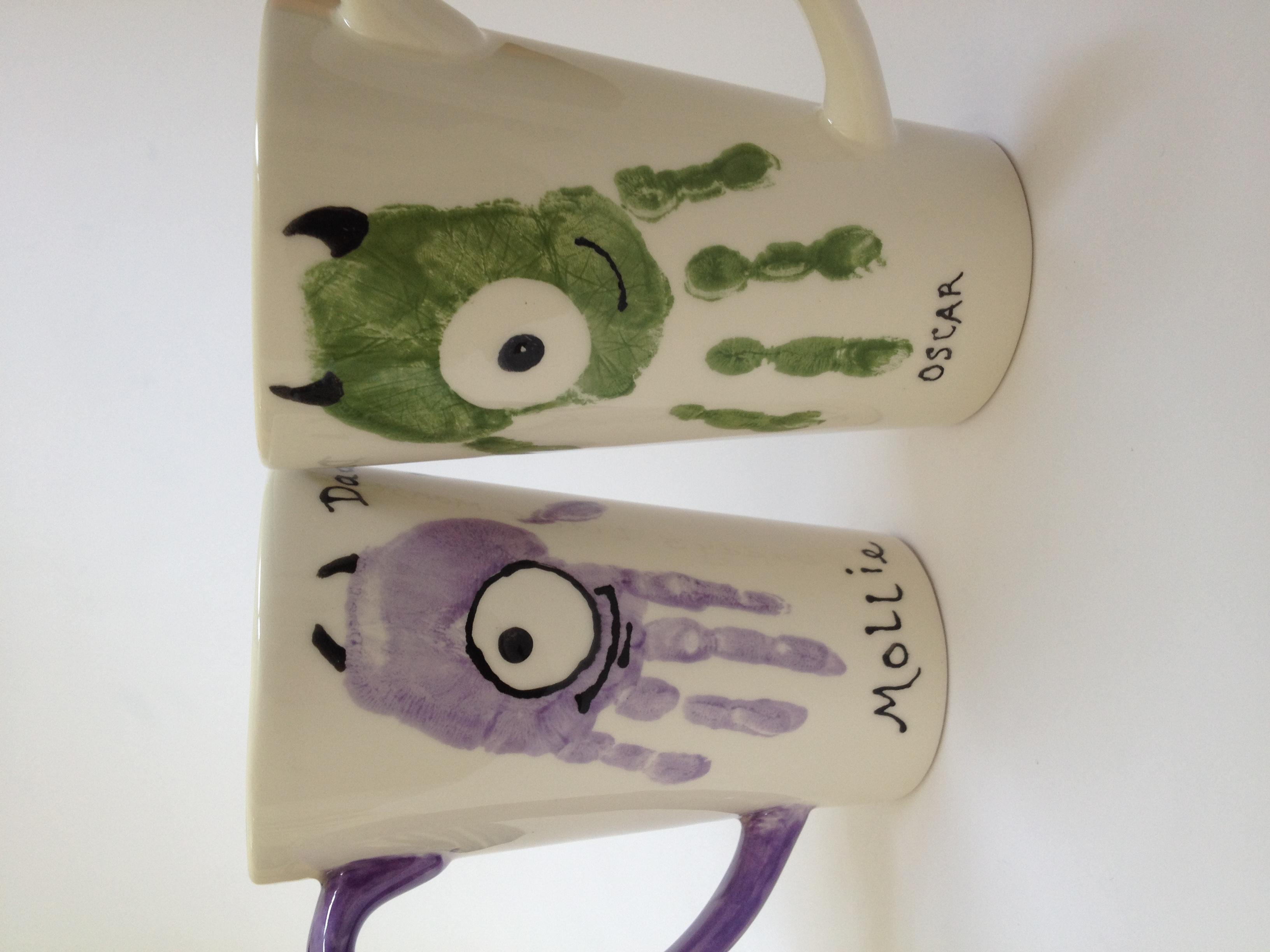 Little Monster handprint mugs