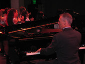 John on piano at one of the many plays at local jr. high and high schools where he was the music director