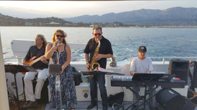On the Condor Express Donna Greene and the Roadhouse Daddies play for a sunset cruise