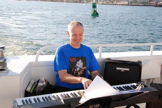 John on keyboard on the Condor Express