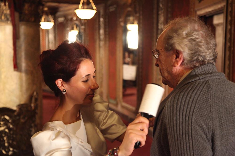 Our amazing wardrobe designer Olga Yarlug tending to Danny  while filming Hereafter Musical [Loews Theater August 2009]