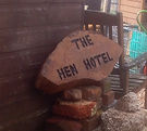 Hen Hotel sign