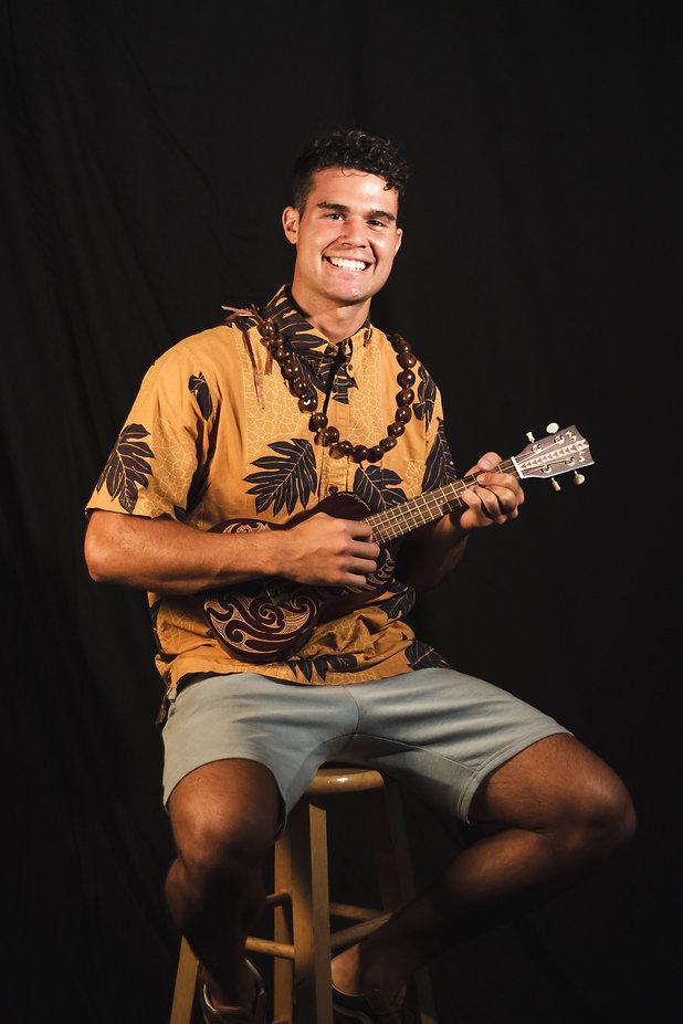 guy playing the ukulele
