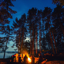 Friends-in-forest-near-bonfire-at-campsi