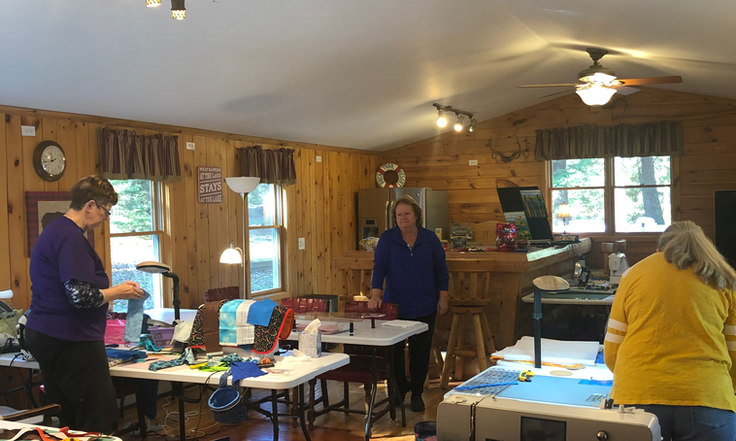 students sewing at quilting workshop minocqua