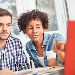 woman teaching man business training