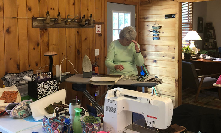 student sewing at quilting workshop