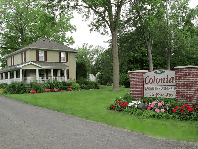Office and front yard sign for colonial townhouses
