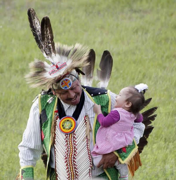father and child native american dancing