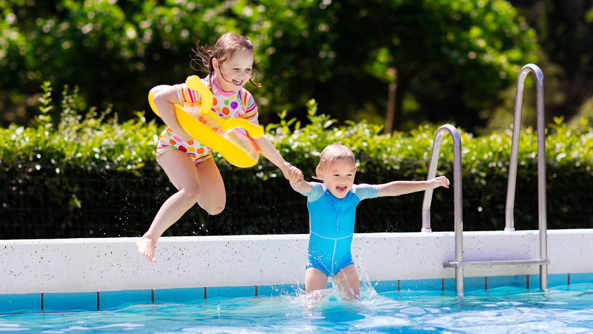 Children Jumping In Pool Poolio Image.jp