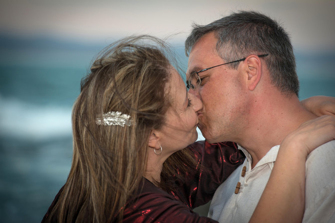 Wedding vows on beach at Supertubes South Africa by DHPhotography