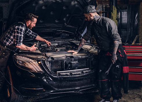 two-bearded-auto-mechanic-working-in-rep