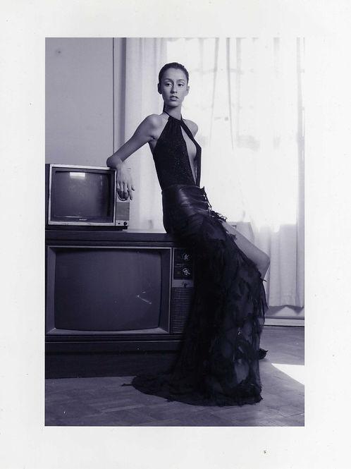 black sparkle knit halter w/black leather hipster skirt w/shredded chiffon