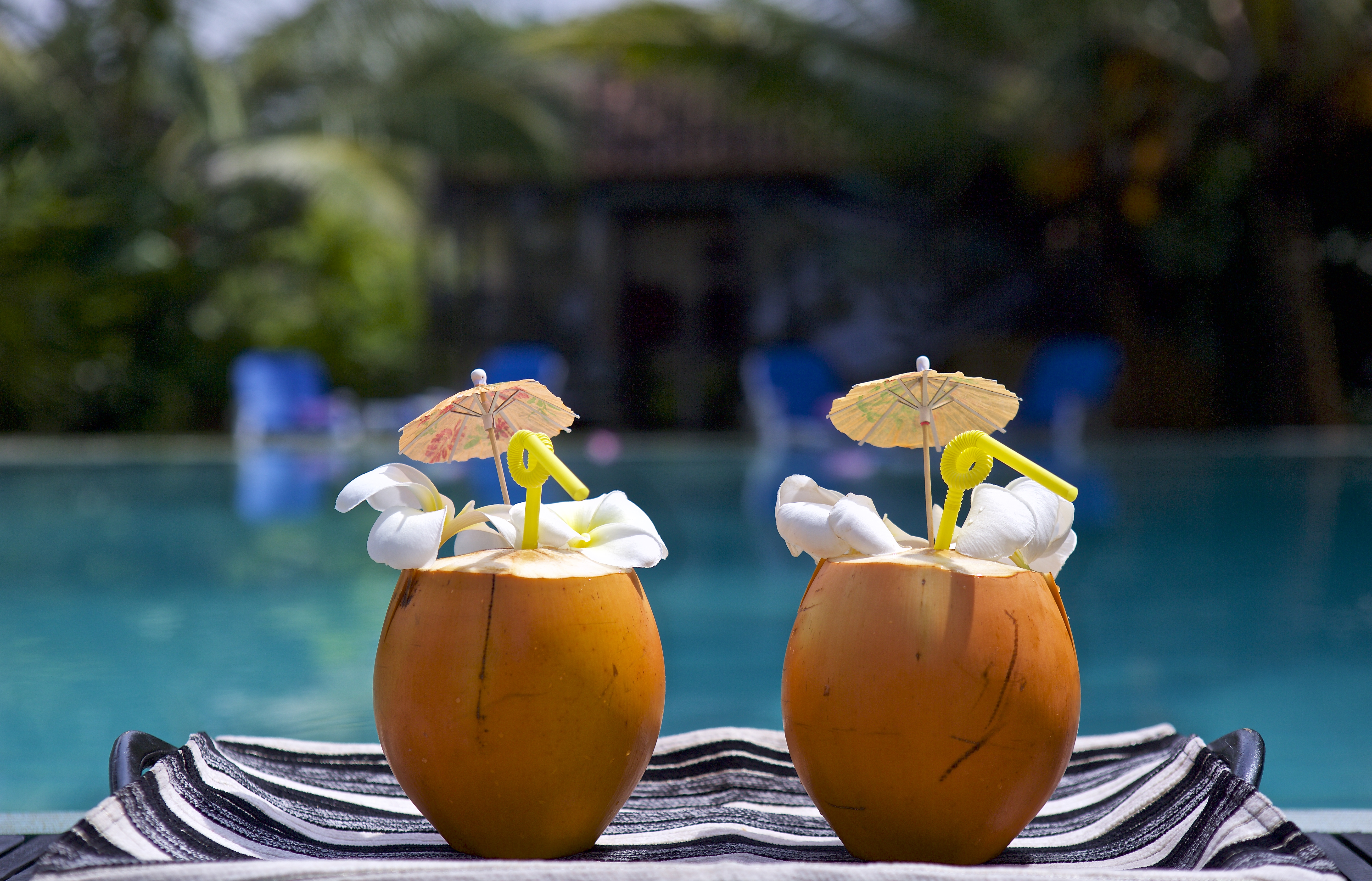 Sri Lanka cocktails by the pool. Coconuts with umbrellas.