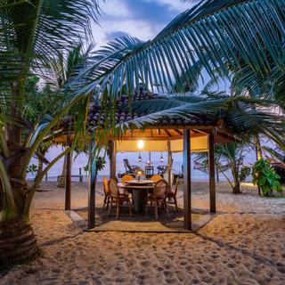 Romantic sunset dinner by the beach