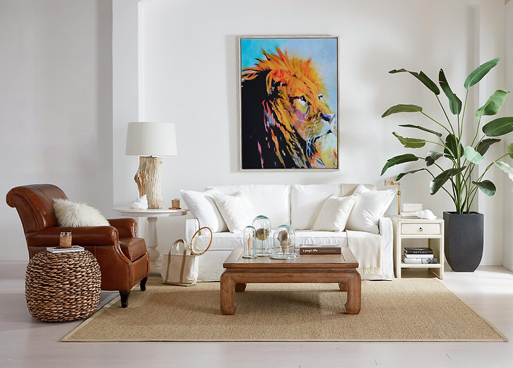 Framed Watercolour Lion art print in a living room above a sofa