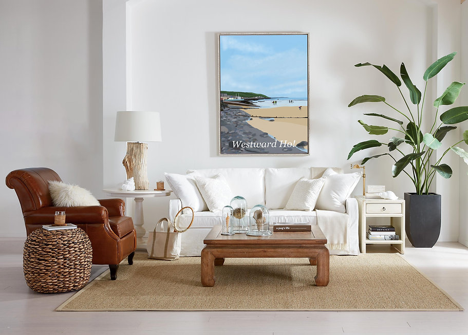 Framed Westward Ho North Devon art print in a living room above the sofa