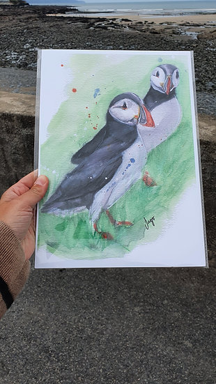 Two Puffins standing in the green grass A4 Art Print - Jagos Art