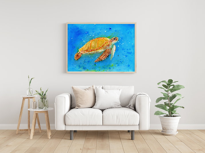 Framed watercolour Sea Turtle art print in a living room above a sofa