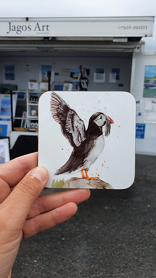 Puffin with outstretched wings stood on a rock coaster Jagos Art