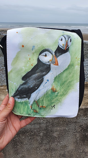 Pair of Puffins standing in the grass shoulder bag Jagos Art