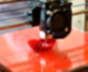 3D printer prints red form.jpg