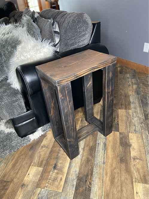 Brown top, black leg end table