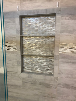 New tile shower with built in shelves