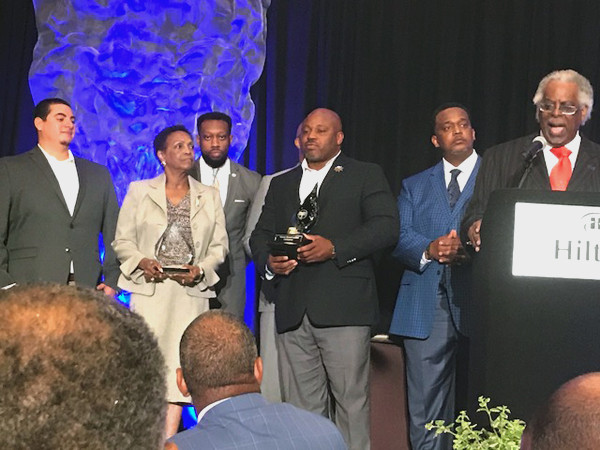 Con-Real Team accepting award