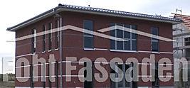 farbiger Reibeputz an Fassade