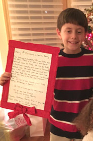 """An """"Adopt-a-Child-for-Christmas"""" Recipient Enjoys his Gift"""