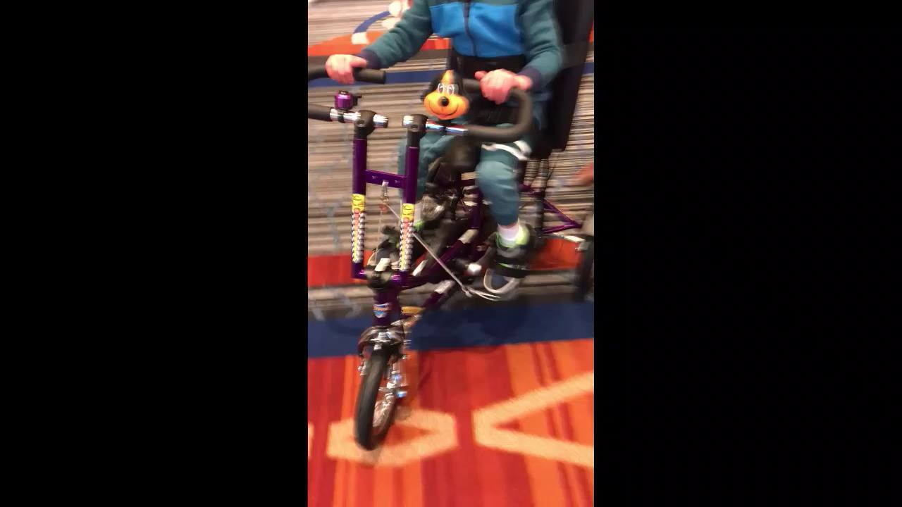 The IWL helped this child enjoy riding a new adaptive tricycle.