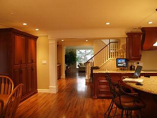solid wood, dark oak kitchen cabinets, pot lights, crown moulding.