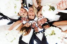 Look from below at bridesmaids anf groom