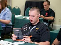 man reading brochure