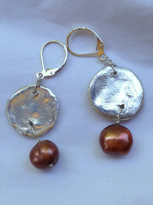 Silver disc with bronze pearl