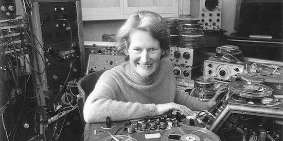 This is a photo of Daphne Oram, a pioneering female composer of electronic music, shown in her studio around 1960.