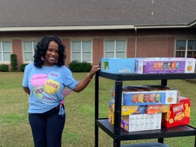 Teacher with cart full of snacks.