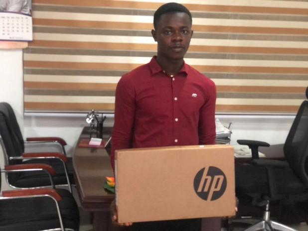 Seth Pepprah, receives his new laptop!