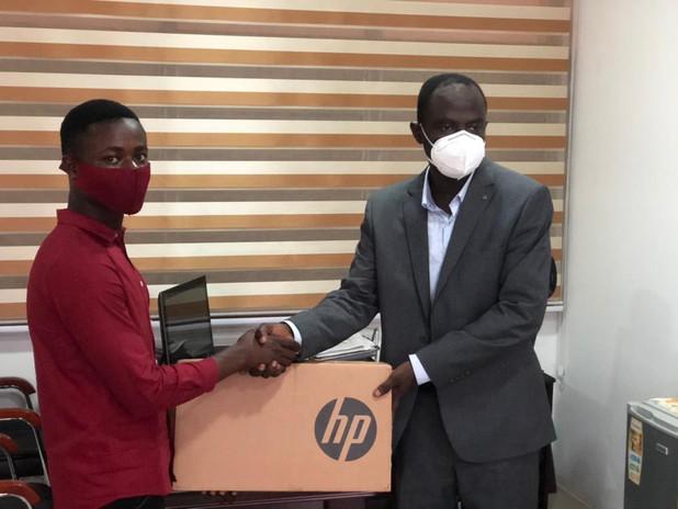 Seth Peppreh receives a new laptop!
